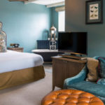 Belmont Fine Arts Contract Interiors framed prints complimenting a blue and brown colour scheme