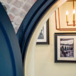 Belmont Fine Arts Contract Interiors - framed prints through a gothic door