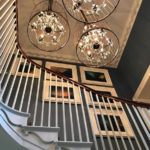 Belmont Fine Arts Contract Interiors wall of framed prints on staircase